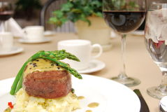 Filet mignon. Over mashed potatoes with asparagus on a restaurant table Stock Photos