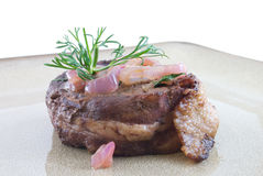 Filet Mignon. Topped with shallots on plate Stock Photography