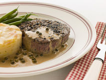 Filet Mignon au Poirve' with French Beans. And Pomme Anna stock photography