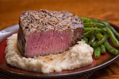 Filet Mignon with Bite taken out, Medium Rare Stock Photos
