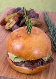Filet mignon burger. With rosemary and baked potatoes royalty free stock image