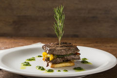 Filet mignon with cassava and vegetables.  stock photo