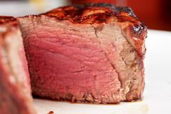 Filet mignon. Char-grilled to medium rare Royalty Free Stock Image