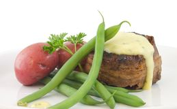 Filet Mignon Dinner. Filet mignon topped with bearnaise sauce with sides of green beans and red potatoes Stock Photo