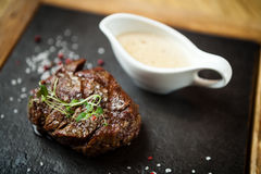 Filet mignon meal. Filet mignon served on a stone board in restaurant Stock Photo