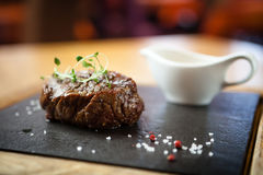Filet mignon meal. Filet mignon served on a stone board in restaurant Stock Image