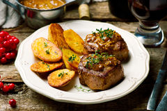 Filet Mignon with a Mustard Sauce. Selective focus royalty free stock photography