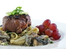 Filet mignon over pasta Royalty Free Stock Image