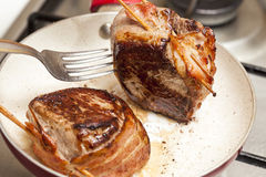 Filet Mignon Preparation. Searing and cooking beef tenderloin medallions stock photo