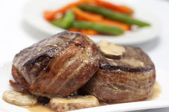 Filet Mignon Preparation. Filet Mignon served with vegetables royalty free stock photography