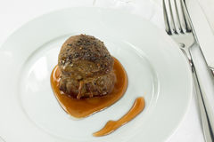 Filet mignon with sauce. Filet mignon tied with string with sauce stock photography