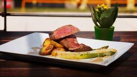 Filet Mignon Steak. Delicious Filet Mignon with asparagus and fingerling potatoes stock photo