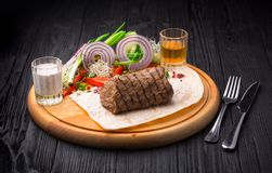Filet Mignon Steak with garnish on wooden board. On black background stock photography