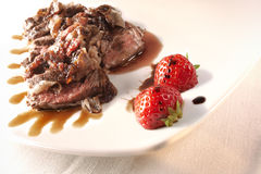 Filet mignon with strawberry s Royalty Free Stock Image