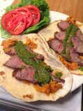 Filet mignon street tacos with chimichurri sauce and green salad royalty free stock photo