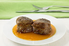 Filet mignon with sweet sauce. Filet mignon tied with string with sweet sauce Royalty Free Stock Image