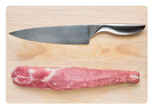 Filet of pork with meat knife Stock Photography