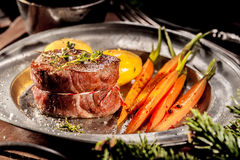 Filet Steak on Metal Plate with Vegetables Stock Photography