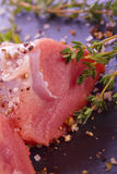 Filet with thyme salt and pepper. Raw fresh filet with thyme salt and pepper Royalty Free Stock Photo