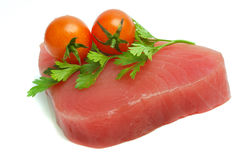 Filet of tuna. Parsley and cherry tomatoes stock image