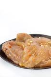 Filet van kippen wit vlees op de zwarte plaat over witte backg Stock Foto's