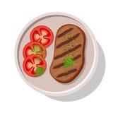 Filete asado a la parrilla de la carne con los tomates Foto de archivo