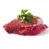 Filete de carne de vaca crudo con las hierbas Imagen de archivo