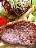 Filete de filete de la carne de vaca con los vehículos Imagen de archivo libre de regalías