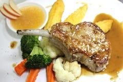 Filete del cordero con la salsa de pimienta picante Foto de archivo libre de regalías