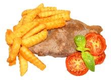 Filete y Chips With Grilled Tomatoes Imágenes de archivo libres de regalías