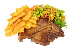 Filete y Chips Meal With Salad del T-hueso imagen de archivo