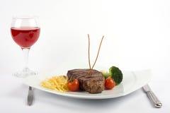 Filete y vino Fotografía de archivo libre de regalías