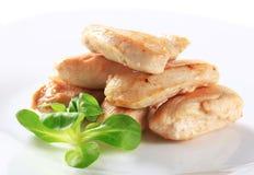 Filetes cocinados del pollo Imágenes de archivo libres de regalías
