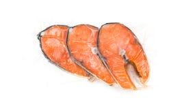 Filetes de color salmón congelados fotos de archivo