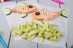 Filetes de color salmón divertidos para los niños Imagen de archivo