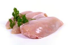 Filetes de pecho de pollo en el fondo blanco imágenes de archivo libres de regalías
