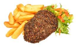 Filetes y Chips Meal sazonados con pimienta de la parrilla de la carne de vaca Imagenes de archivo