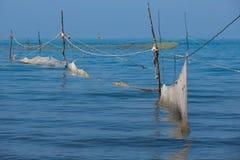 Filets de pêche en mer, Olginka, Russie Photographie stock libre de droits