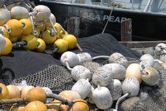 Filets de pêche et flotteurs Photos stock