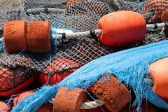 Filets de pêche et flotteurs d'orange Photos libres de droits