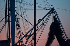 Filets de pêche le soir Photographie stock