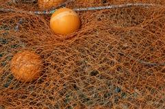 Filets de pêche oranges Images stock