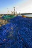 Filets de pêche sur le quai de port Photographie stock libre de droits