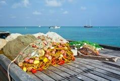 Filets de pêche sur un dock Image libre de droits