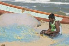 Filets de pêche de réparation Images libres de droits