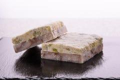Filets de poissons congelés avec de la sauce Photographie stock libre de droits
