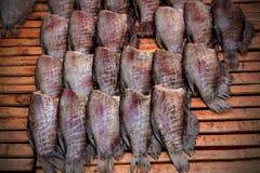 Filets de poissons secs sur le fond blanc Photographie stock libre de droits