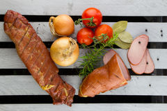 Filets de porc coupés en tranches fumés Jambon fumé fait maison de porc Photos stock