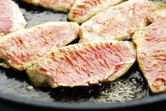 Filets of sea barbel in pan, close-up Stock Photos