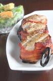 Filetti di carne di maiale avvolti bacon fotografia stock